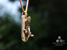 Unicycle Pendant in Stainless Steel