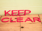 Keep Clear sign in Red Strong & Flexible Polished