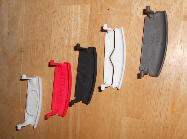 Audi A4 B6 armrest lid with spring pure 3d printed Overview of available parts: (left to right) part with spring replacement, red, black, with and original part
