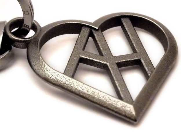 Heart of love keychain [customizable] 3d printed A close look to heart of love keychain (customizable initials, key ring not included) [printed in polished nickel steel]