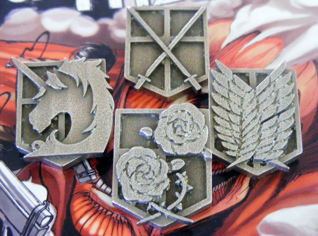 Attack On Titan Emblems - Set Of 4 3d printed This shows how the emblems will arrive, with the support material still in the fine details.