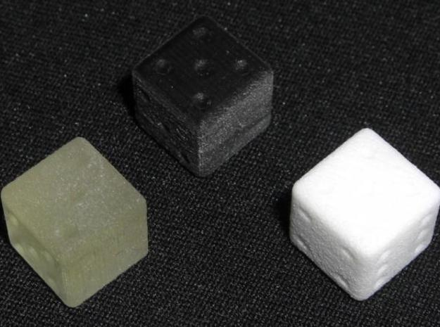 dice 3d printed In black, transparent detail and white strong and flexible.