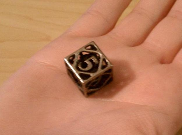 Cage Die6 3d printed In stainless steel and inked.