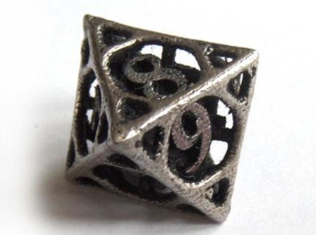Cage Die8 3d printed In stainless steel and inked