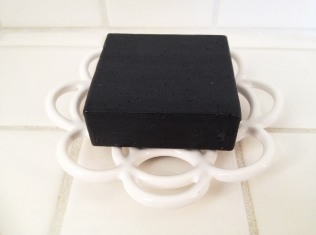 Circles Soap Dish 3d printed Shown here with black charcoal soap