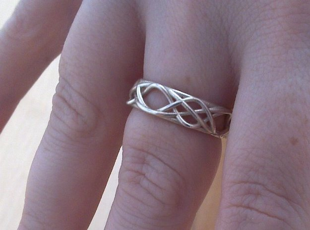 Sine Ring Irregular 3d printed Ring printed in silver being worn.