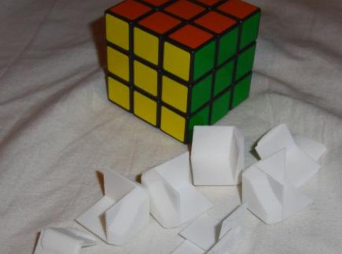 Here's the White Strong & Flexible parts, next to the Offical 3x3 Rubik's Cube.
