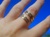 Bars & Wire Ring Size 12 3d printed Photo of the ring from the top, printed in polished brass, size 10.