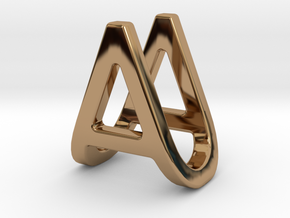 AU UA - Two way letter pendant in Polished Brass