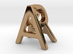 AR RA - Two way letter pendant in Polished Brass