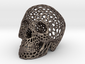 Human skull skeleton perforated sculpture in Polished Bronzed Silver Steel