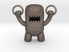 Domo Monster doing exercises with rings in Polished Bronzed Silver Steel