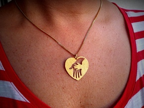 Mother/child holding hand pendant. in Polished Gold Steel