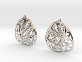 Organic and angular earrings in Platinum