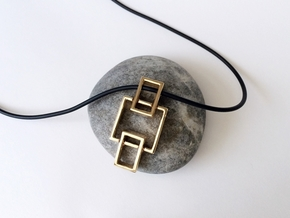Chain Pendant - Created with interlocking metals. in Interlocking Polished Bronze