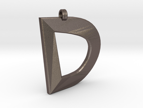 Distorted Letter D in Polished Bronzed Silver Steel