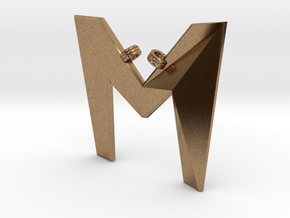 Distorted letter M in Natural Brass