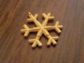 A wee snowflake pendant in Polished Gold Steel