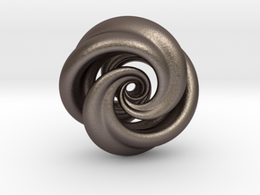 Integrable Flow (7, 2) in Polished Bronzed Silver Steel