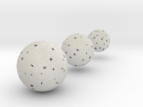 Expanding universe globes in Natural Full Color Sandstone