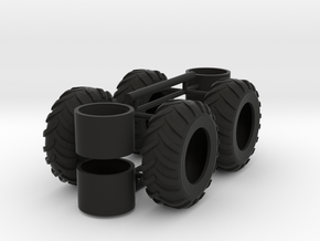 1/64th Log Skidder Tires, regular stock size in Black Natural Versatile Plastic