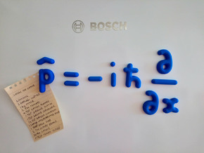 Scientific Fridge Magnets: The Momentum Operator in Blue Processed Versatile Plastic