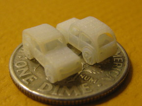 Pair of tiny micro cars with turning wheels in Frosted Ultra Detail