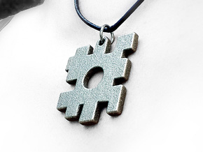 The missing piece pendant in Polished Bronzed Silver Steel