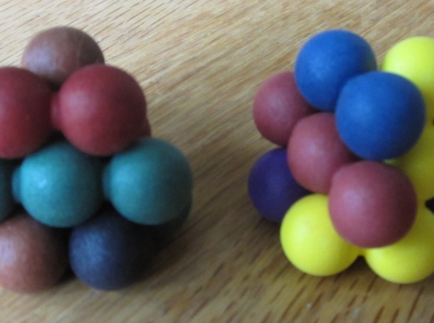 "Ell of a puzzle (spheres) 3d printed Assembly into two interlocking ""blossoms""."