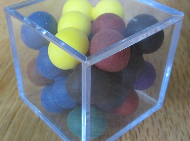 Ell of a puzzle (spheres) 3d printed Solved puzzle in golf ball case.