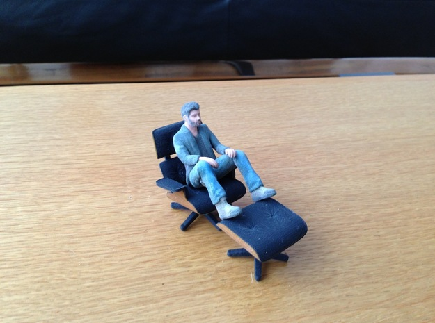 An Itty Bitty Sad Keanu 3d printed Sad Keanu lounging in KSpence's 3d printed Eames Chair
