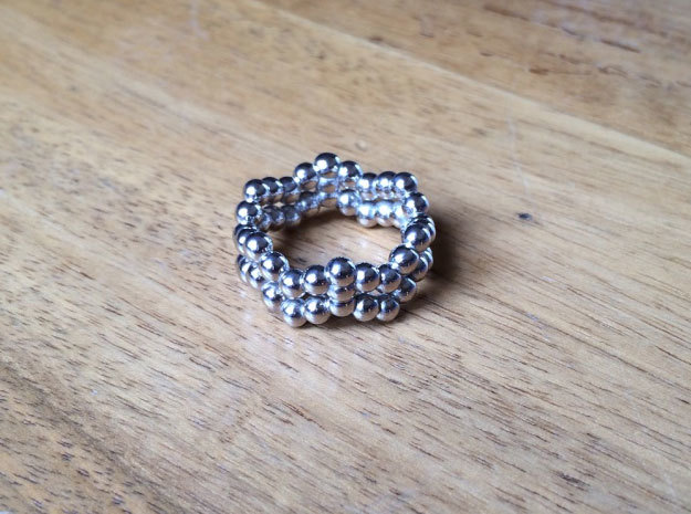 Ring Sphere 2 waved in Rhodium Plated