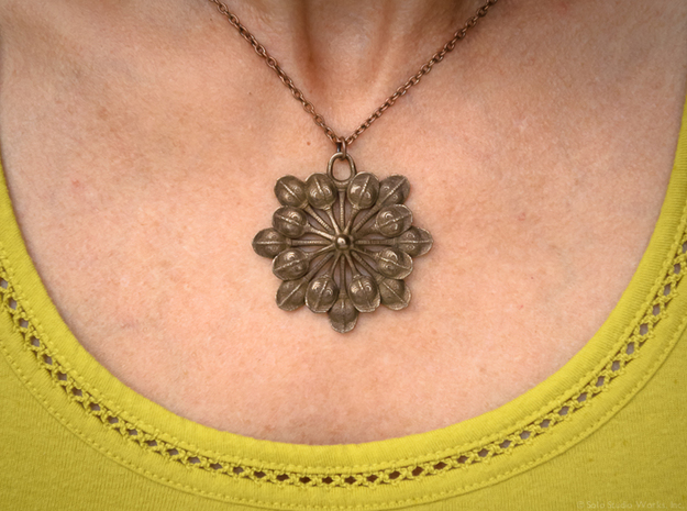 Sun Petals Pendant 3d printed Polished Bronze Steel
