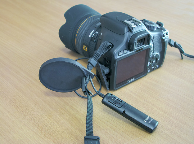 Holder for the camera lens cap . in Black Strong & Flexible