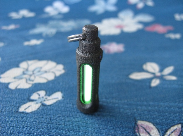 Tritium Lantern 1C (Stainless Steel) 3d printed In this picture the phosphorus coating on the tritium vial being energised by UV light.