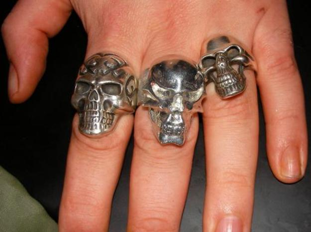 Skull Ring 3d printed The shiney new pewter amidst the extant silver rings.  The oewter is similar in colour - a little bit brighter in this pikkie.