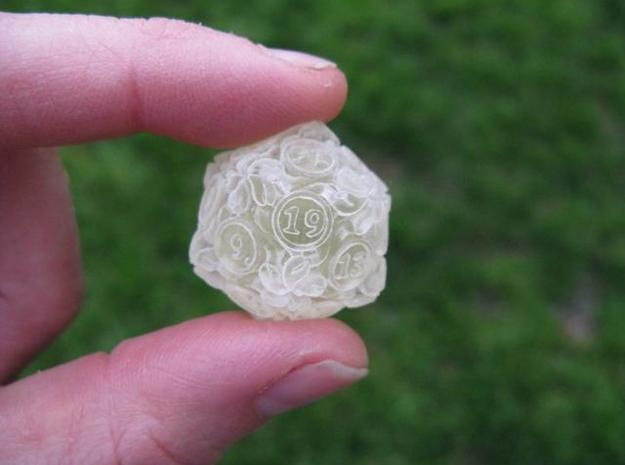 20-sided die with leaves 3d printed In transparent detail.  This one is pretty solid and not that clear.  It did not really hollow out.