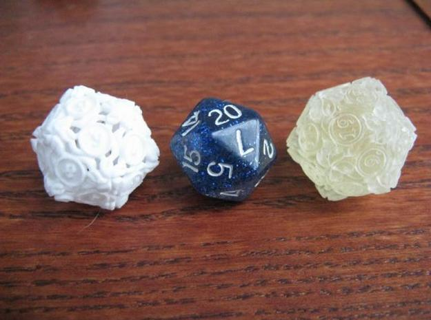 "20-sided die with leaves 3d printed WSF and Transparent detail, next to an ""average"" 19mm d20 for size comparison.  They are a little larger to get all the detail in."