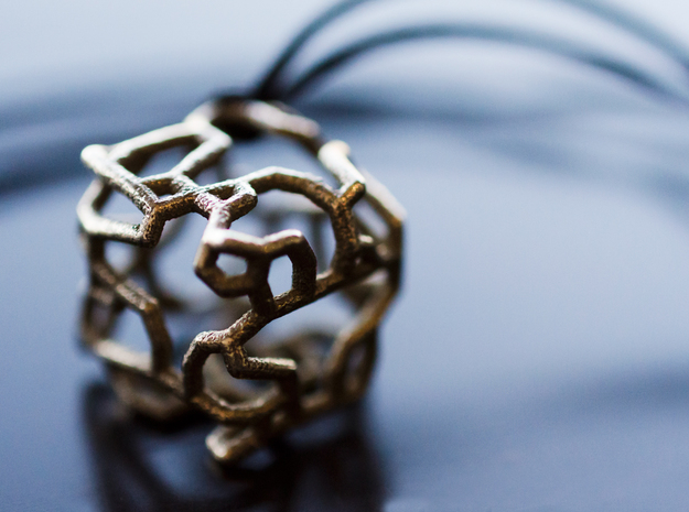 Stylized cube with an organic design in Stainless Steel