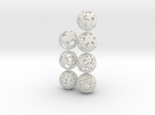 Comma symmetry spheres: 7 infinite families in White Natural Versatile Plastic
