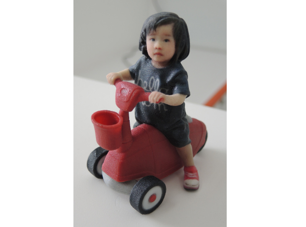 Scanned Little Girl rides a toy car - 8CM High in Full Color Sandstone