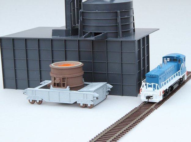 N-scale 250t Ladle Transfer Car 3d printed 250 ton Ladle Transfer Car shown with ladle (not included) and Walthers Cornerstone Electric Furnace as a background for size reference.