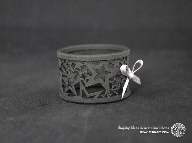 A large Christmas napkin ring with Stars in Black Natural Versatile Plastic