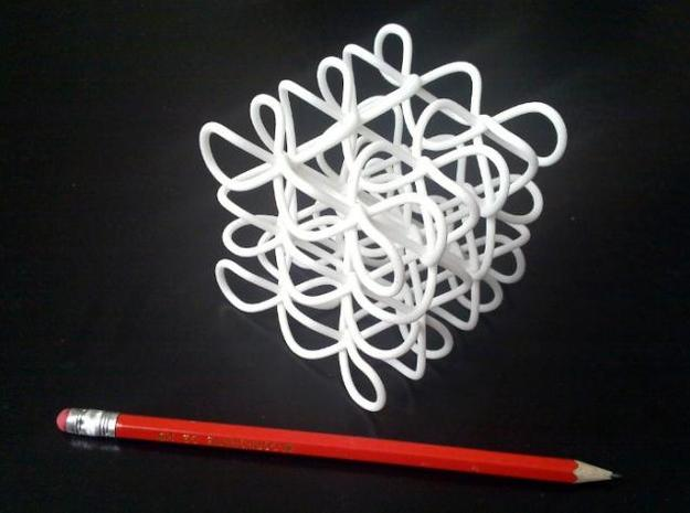 Celtic Knot Cube 3d printed The physical printed knot next to a pencil to indicate size.