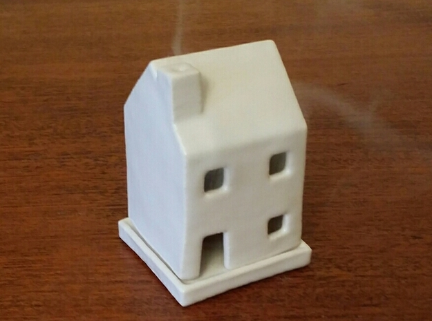 House Incense Burner 3d printed House incense burner with steam rising from the chimney