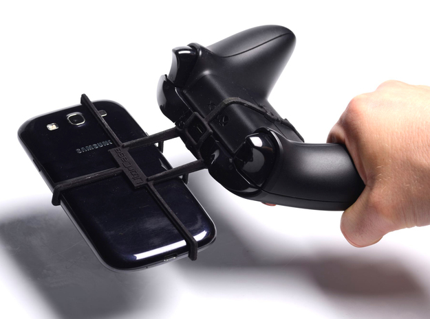 Xbox One controller & Karbonn A3 3d printed In hand - A Samsung Galaxy S3 and a black Xbox One controller