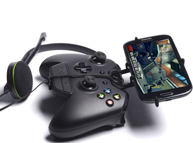 Xbox One controller & chat & Alcatel One Touch Scr 3d printed Side View - A Samsung Galaxy S3 and a black Xbox One controller & chat