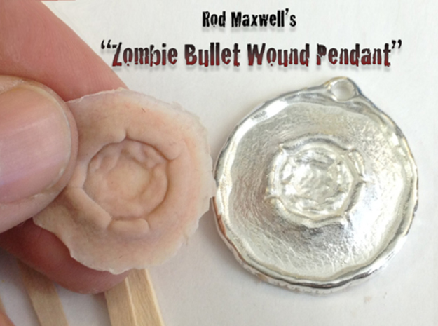 Sterling Silver Bullet Wound Pendant 3d printed Shown with a silicone prosthetic appliance that was cast directly from the back of the pendant! Silicone not included.