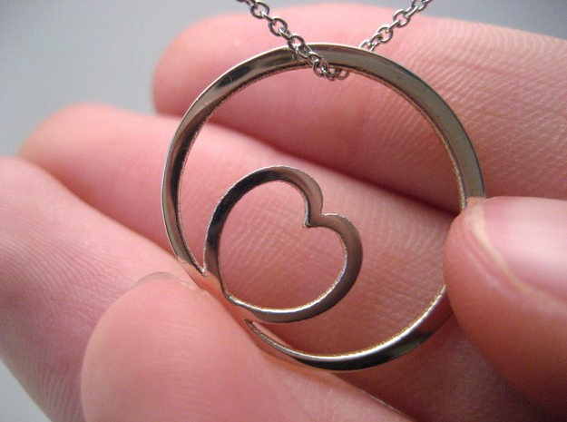 Encircling Love Pendant in Polished Silver