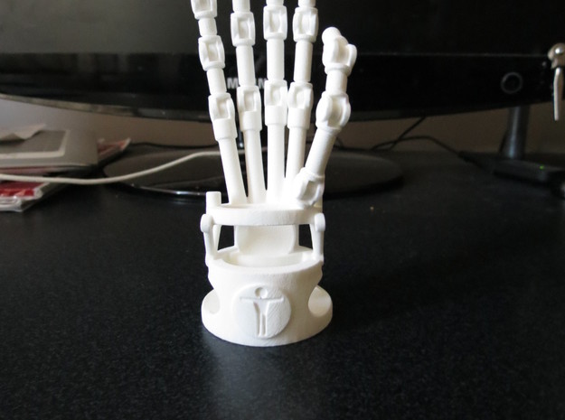 Robot hand phone stand in White Strong & Flexible